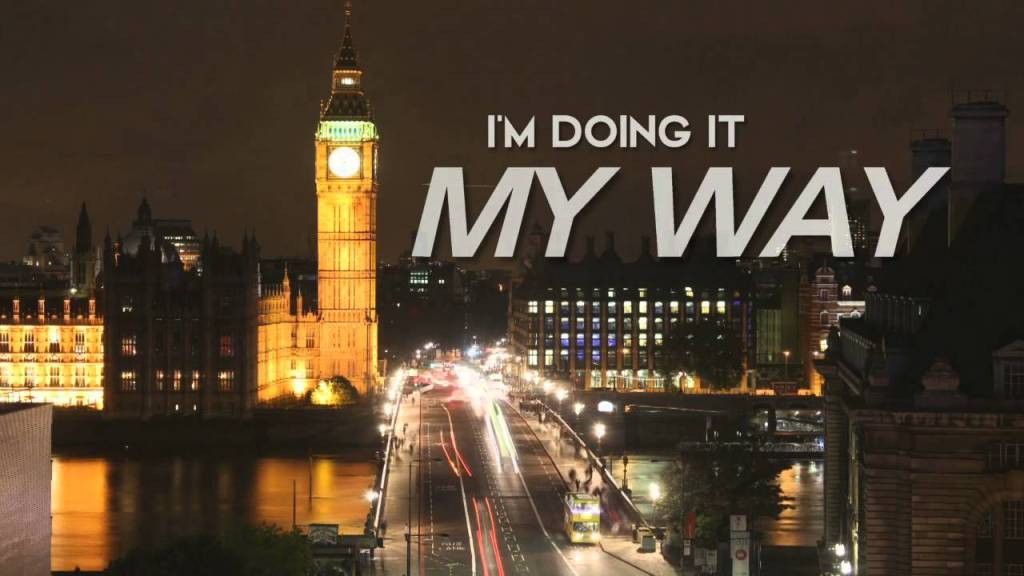 "A picture of a bridge in London over the Thames river with Big Ben in the distance at night time with cars going over the bridge. A caption is at the top of the image.  The caption says: ""I'm doing it MY WAY."""